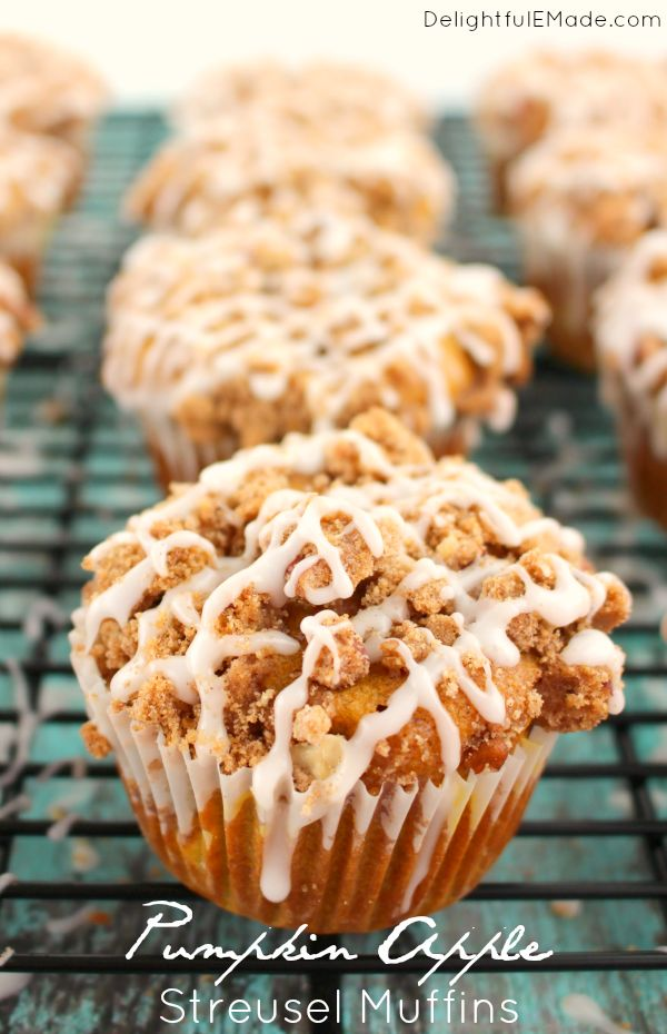 All of your fall favorites in one delicious breakfast treat!  These Pumpkin Apple Struesel Muffins are wonderfully moist, with big chunks of apples baked inside with a delicious streusel and glaze on top.  Bakery quality muffins right at home!