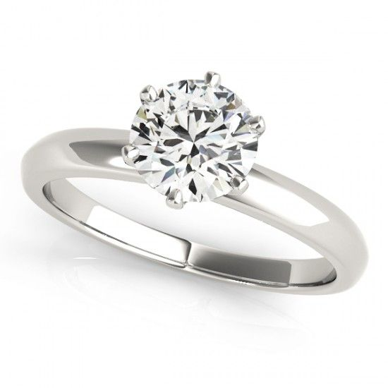 ''Tiffany'' Iconic Six Claw Round Solitaire Engagement Ring A unique and iconic Tiffany inspired round brilliant cut diamond solitaire engagement ring with 6 claw setting and tapering shoulders.