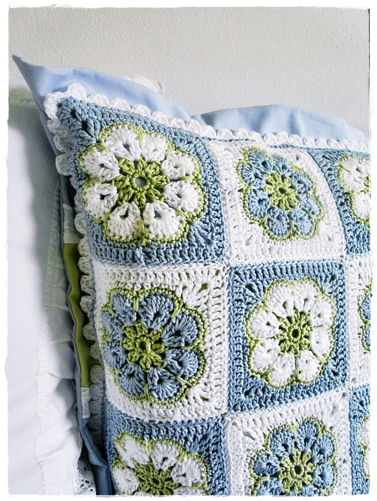 "Kirsten - My World - African flower cushion. Very nice. No pattern for this one, but there is a lot of African Flower tutorials when you Google ""How to crochet an African flower"""