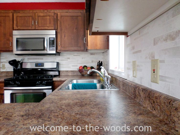 A painted faux tile back splash that I created in my kitchen. A versatile and inexpensive way to try out a tile look for your kitchen back splash.