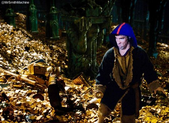 @MrSmithMachine - It's official, Michael Phelps now has more gold than Smaug.