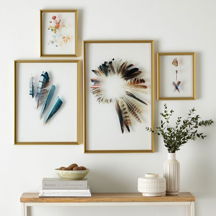 Wall art framed feathers and stones