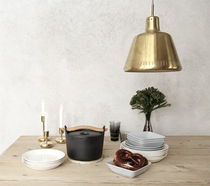 Iittala Christmas Home. Iittala + Time of the Aquarius collaboration. Nappula brass candleholders, Sarpaneva cast iron pot, Teema dishes, Kartio glasses.