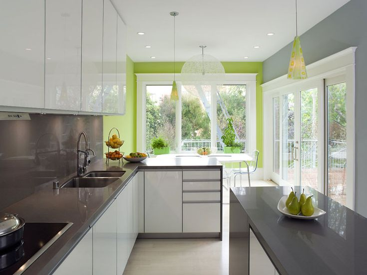 Spring green kitchen with white cabinets and gray counter tops. The gray counter tops are kind of cool looking.