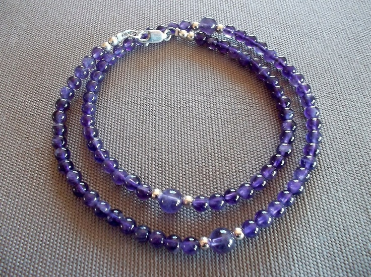 Handcrafted necklace featuring 4mm and 6mm genuine amethyst beads, and sterling silver beads and clasp. 18 inches in length.
