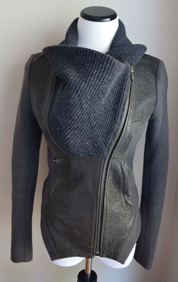 Authentic Helmut Lang Pebbled Leather Sleeve Jacket. FEATURES :Long pebbled leather sleeves. CONDITION : Pre-Owned and in good overall condition. The only sign of handling is the wool portion of the jacket is lightly pilled.