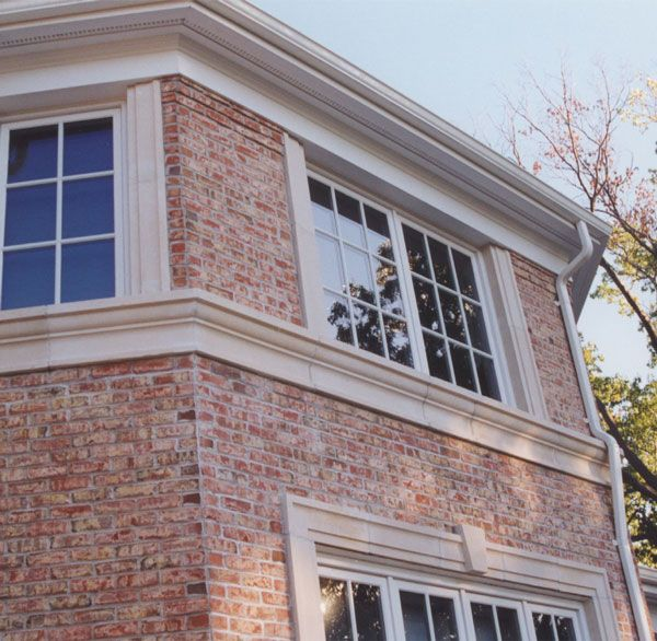 Architectural Window Sills : Cast stone midline banding forms window sill for second