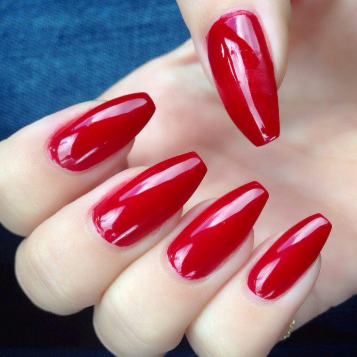 Red Nail Polish On Thumb: Long Squared Off Nails With A Red Nail Polish Coating
