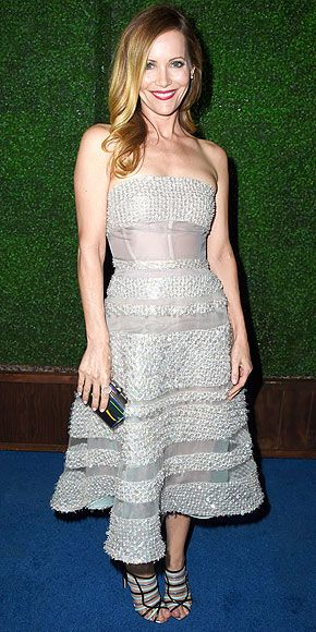 Must-See Looks from the Critics' Choice Awards | LESLIE MANN | This sequin-and-sheer-panel Reem Acra cocktail dress is the perfect party look – especially when paired with playful accessories like Leslie's strappy blue and black heels and iridescent clutch.