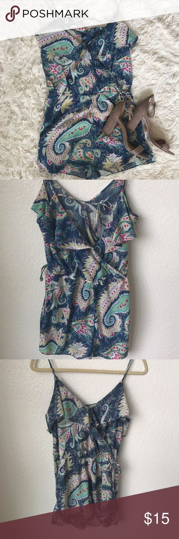 American outfitters romper Super cute American outfitters  multicolor romper. Cross cross back  a tie in the back and adjustable straps. Also has pockets . Wear dressy for a night out or sandals to keep it casual. American Eagle Outfitters Other