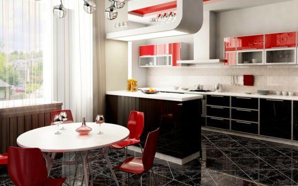 cuisine ouverte sur la salle à manger, petite table ronde et chaises rouges, rangement en rouge et blanc