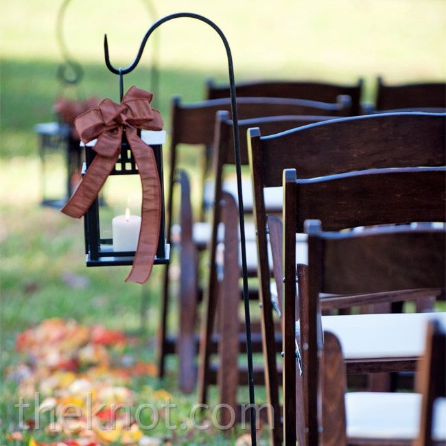 Brown Satin Ceremony Decor- line your walk down the aisle with dimly lit lanterns adorned with chocolate satin bows. photo by: NIna Sutherland Photography