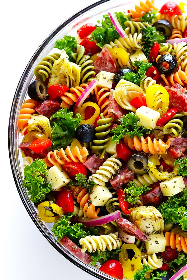 This Rainbow Antipasto Pasta Salad is the perfect way to use up leftover antipasto ingredients! Plus, it's easy to make, tossed with a zesty Italian herb vinaigrette, and absolutely delicious! | gimmesomeoven.com