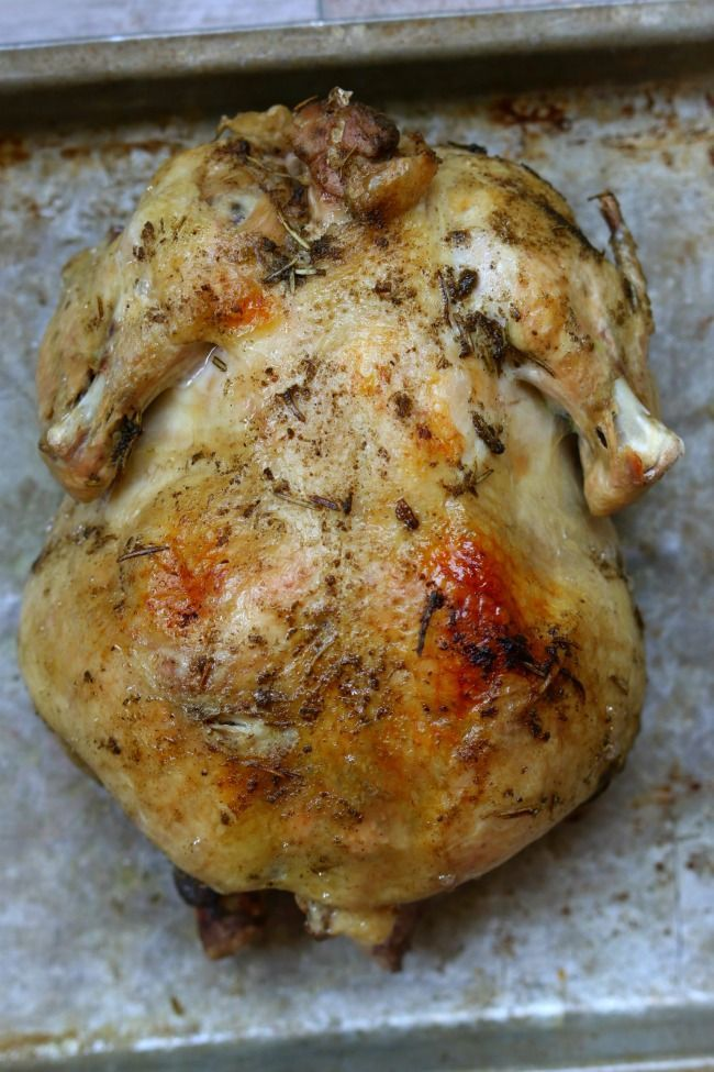 Slow Cooker Herbed Whole Chicken-- If you love getting those whole rotisserie chickens at your grocery store, you'll love this recipe for slow cooker whole seasoned chicken. The chicken is cooked in  your slow cooker and then stuck under the broiler to crisp up the skin. Slice the chicken up to eat plain or use it in any recipes that call for cooked chicken.