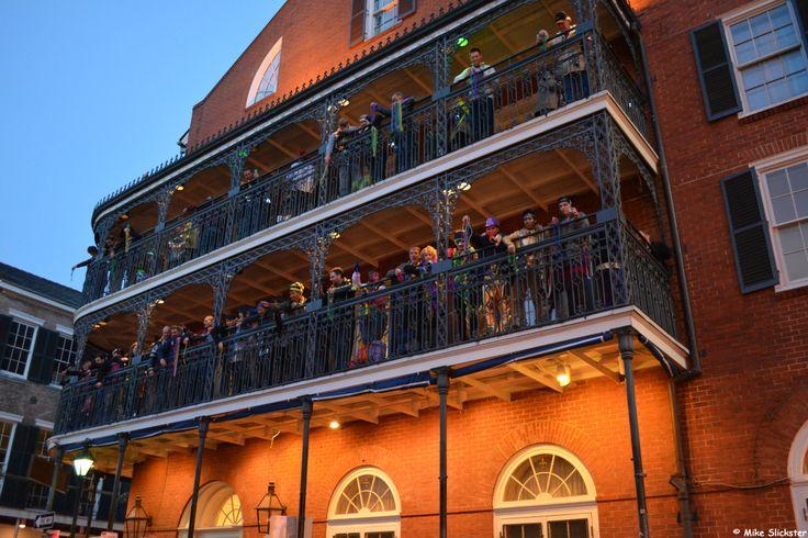 Mardi Gras Revelers on the Balconies of the Royal Sonesta Hotel on Bourbon Street.