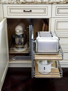 Keep Small Appliances Out of Sight. Use pull single or 2-tiered pull out drawers. #organize #kitchens #lowercabinets