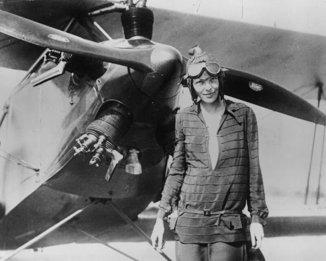 Amelia Earhart, the first female pilot to fly solo across the Atlantic Ocean, with Bi-Plane June 14, 1928.