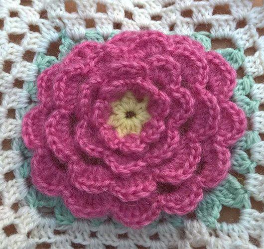 Crocheted rose granny square blanket