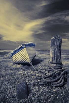 Porlock Weir - Blue and White boat in infra red - stock photo