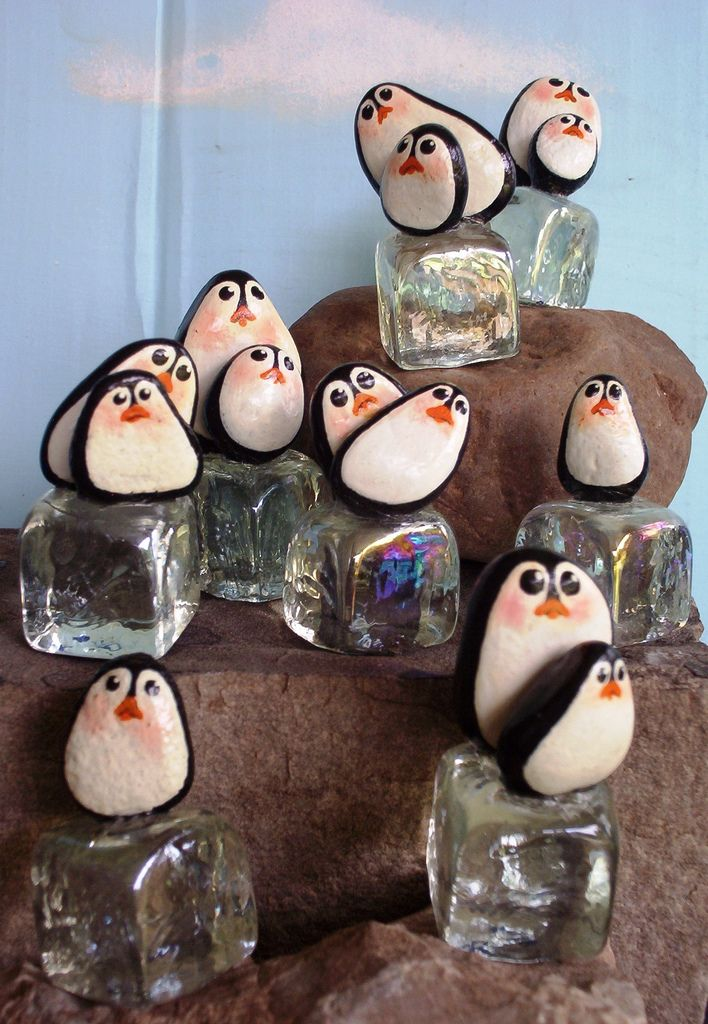 PENGUINS ON ICE Limited Series of hand painted rocks mounted on glass ice cubes. Eight pieces in series.