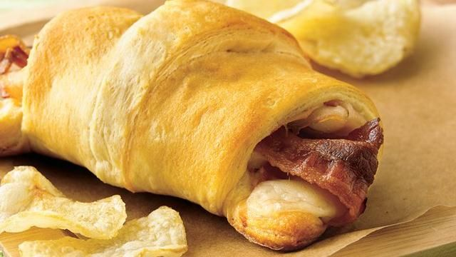 Turkey, Bacon and Cheese Sandwich Recipe... Turkey, Swiss cheese and bacon are spiced with Dijon mustard and swaddled inside a refrigerated crescent dinner roll in these flaky sandwiches served right from the oven.