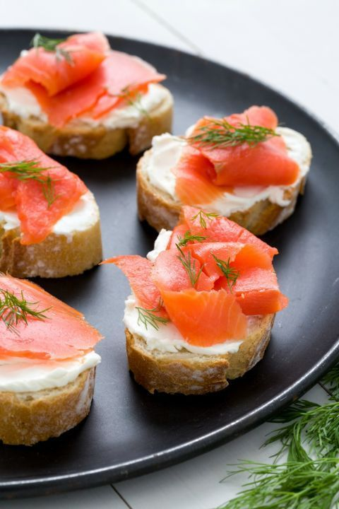 Top toasted or fresh baguette slices with cream cheese, thinly sliced smoked salmon, and fresh dill for everything you love about a bagel with lox.