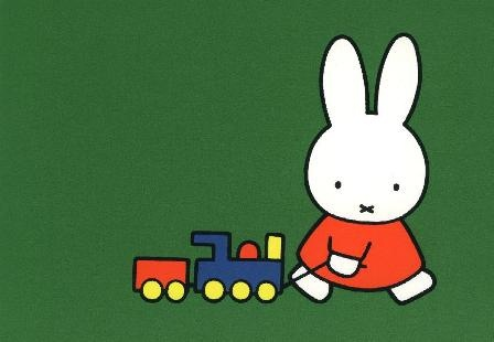 Miffy playing with a train