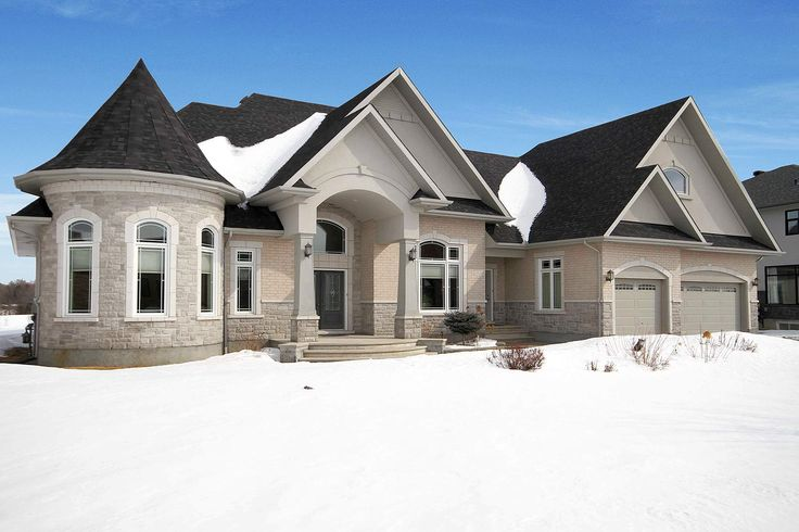 Located on a prime ravine lot, this striking bungalow was constructed proudly by Mikac Construction offering unique architectural features including high roof lines, an interesting turret, extensive use of windows, and an exterior finish blending the use of stone, brick and stucco.