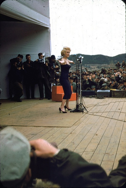 Marilyn Monroe appears onstage entertaining troops on her USO tour through Korea in 1954.  From the Robert H. McKinley Collection (COLL/4802) at the Marine Corps Archives and Special Collections