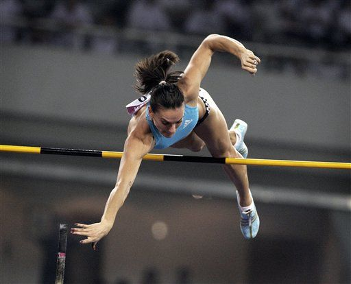 Beijing Olympic pole vault champion and world record holder Yelena Isinbayeva of Russia competes in the Women's Pole Vault at th Photo,Beijing Olympic pole vault champion and world record holder Yelena Isinbayeva of Russia competes in the Women's Pole Vault at th Pictures, Stills, Beijing Olympic pole vault champion and world record holder