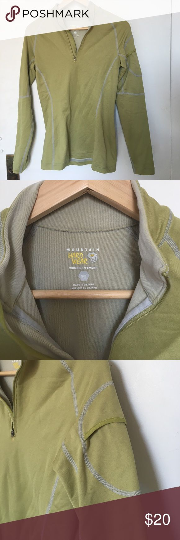 Mountain Hard Ware Stretchy Pullover Light moss green pullover from Mountain Hard Ware. 1/4 front zip and external pocket on upper left arm that's convenient for storing your phone while exercising or hiking. Fitted but stretchy fabric, nylon/polyester blend. Size: S. Mountain Hard Wear Tops
