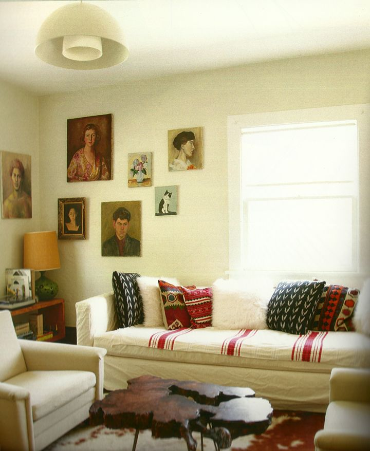 .: Coffee Tables, Living Rooms, Portraits Wall, Laur Joliet, White Rooms, Cows Hiding, Couch Pillows, Sofas Covers, White Wall