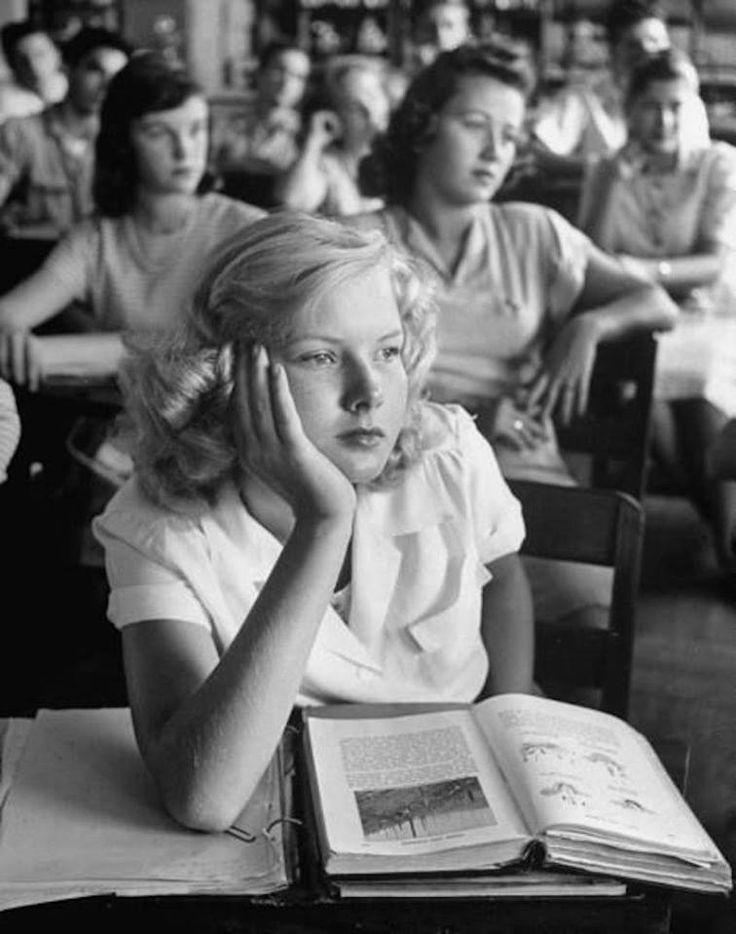 """A girl daydreaming during class, Florida, March 1947. Photo by Allan Grant."""