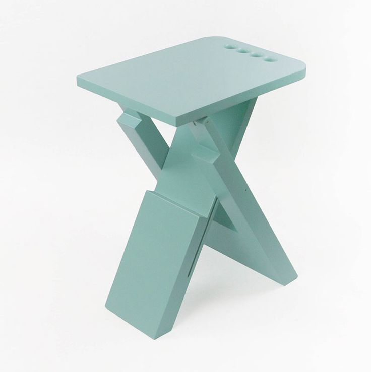 Made of lacquered wood, this simple folding and compact stool features four holes in the seat that work as a handle when you need to carry it somewhere.