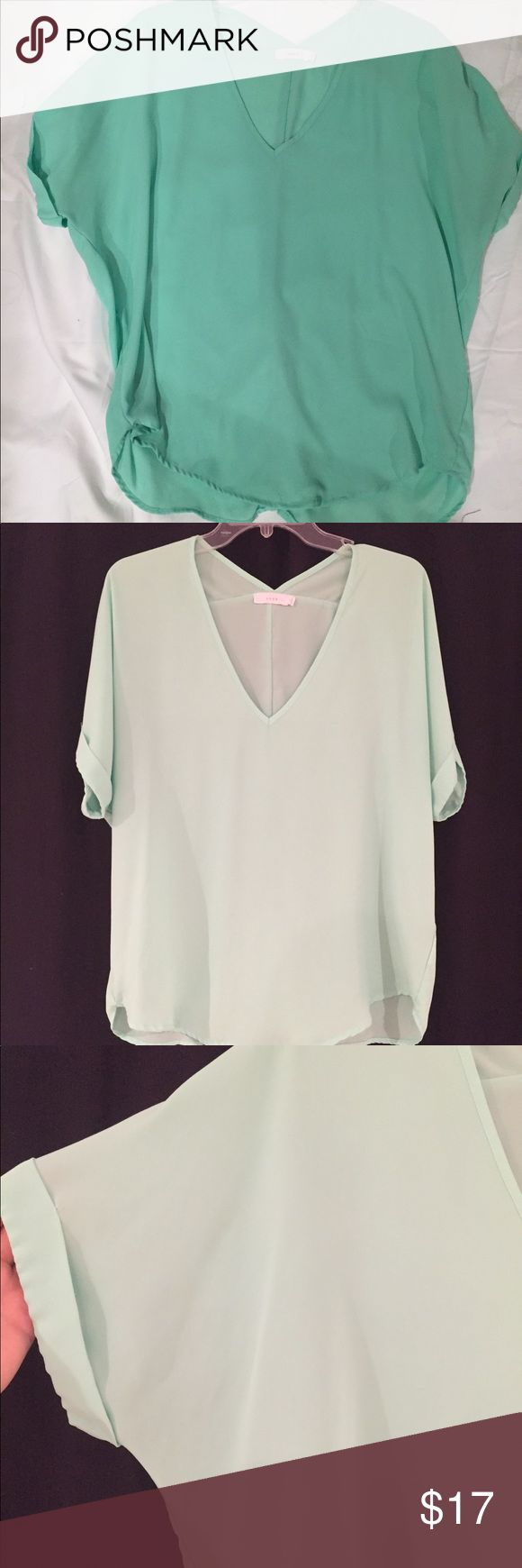 LUSH Mint Blouse Super cute mint colored short sleeve flowy top. That really is the same top- the picture just comes through horrible against the black! So pretty and the v neck details are adorable! Lush Tops Blouses