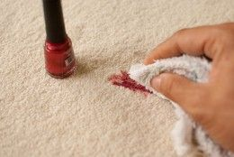 Dab excess polish with a towel to get nail polish out of carpet.