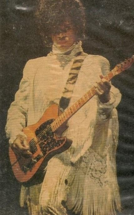 """Salvaged Purple Rain Tour Photo! Salvaged meaning if it weren't for that one fan that scanned this from a magazine or newspaper it would of been lost! This is Prince's """"I Would Die 4 U"""" outfit but he wouldn't play his Hohner guitar during that performance...which is interesting... I'm 'purple factoid' nut, sorry... thinking out loud..."""