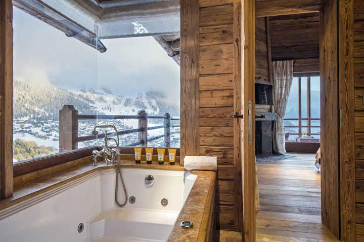Chalet Mon Izba - Bathroom with a view!  Available from the Firefly Collection. #mountainviews #luxuryskichalet