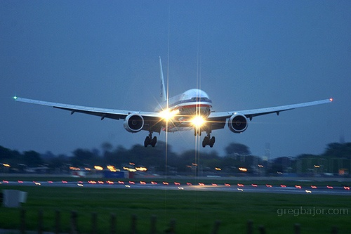 American Airlines Boeing 777 200 late evening arrival at London Heathrow Airport UK
