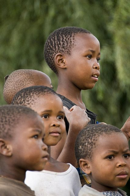 Family, Kingdom in the Sky, Lesotho, Africa  It's the hair style that do it....