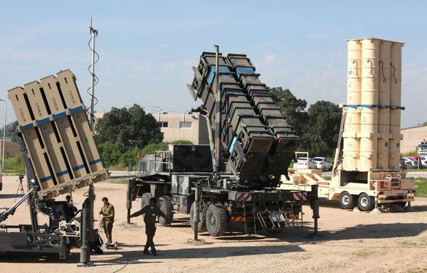 Israeli soldiers walk near an Israeli Irone Dome defence system (L), a surface-to-air missile (SAM) system, the MIM-104 Patriot (C), and an anti-ballistic missile the Arrow 3 (R) during Juniper Cobra's joint exercise press briefing at Hatzor Israeli Air Force Base in central Israel, on February 25, 2016. Juniper Cobra, is held every two years where Israel and the United States train their militaries together to prepare against possible ballistic missile attacks, as well as allowing the…