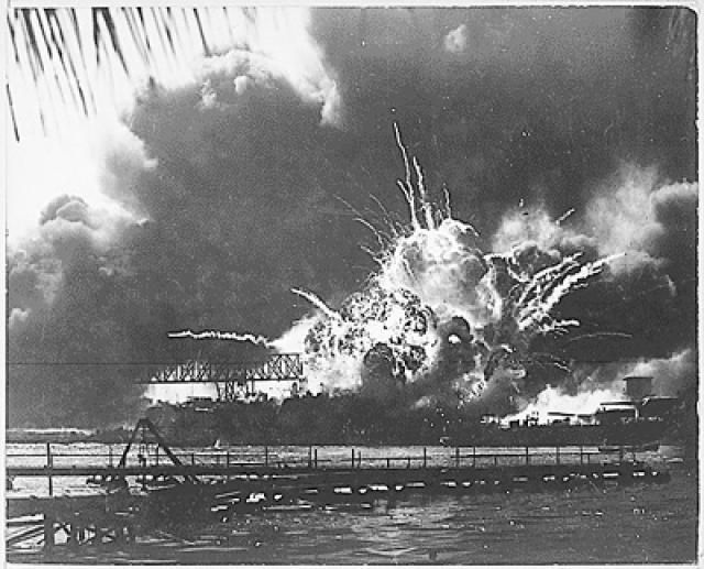 Picture of the USS Shaw exploding during the Japanese raid on Pearl Harbor. - (Picture courtesy of the National Archives and Records Administration)