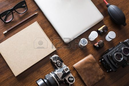Work space for photographer designer or hipster style Have a laptop film camera film speaker glasses Stock Photo