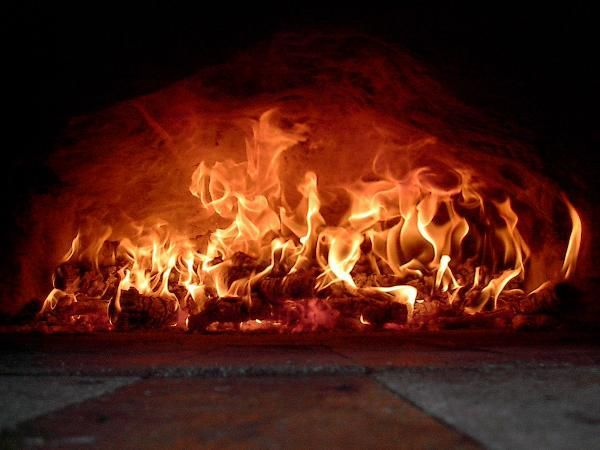 Fire within an original Fornino wood-fired pizza-oven