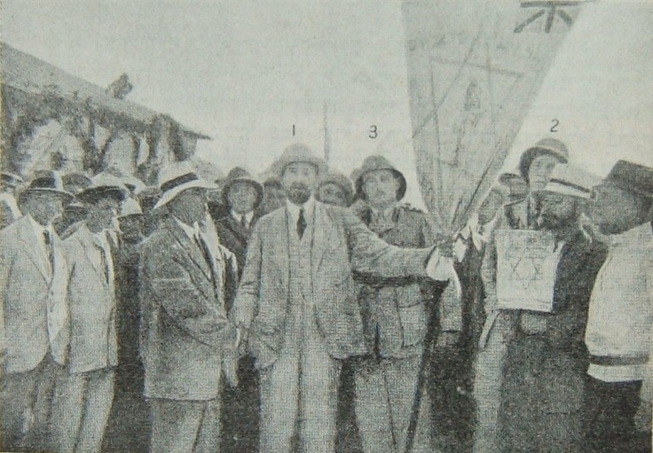 The Jewish Legion of WW1 consisted of three battalions: one from British volunteers (the 38th), another of North American volunteers (the 39th) and a third one of volunteers from Eretz Israel-Palestine (the 40th). Seen here is Dr. Chaim Weizman, a leading Zionist figure instrumental in the drafting of the Balfour Declaration (1917) and future first President of Israel presenting the colors of the 40th Battalion to its members, 1918.