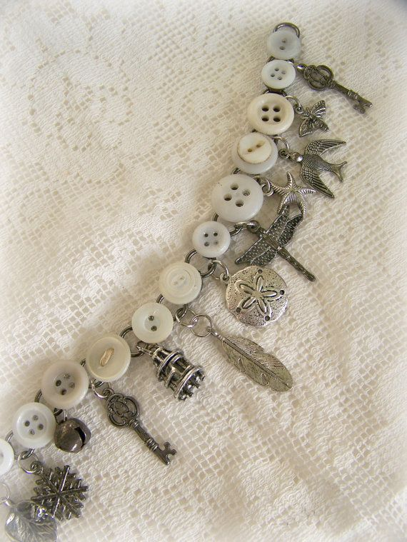 12 unique nature themed charms adorn this bracelet assembled with vintage buttons. Made from old found objects, unique charms and several styles of vintage white buttons. Very comfortable to wear, and perfect for the vintage and antique lover. Every piece