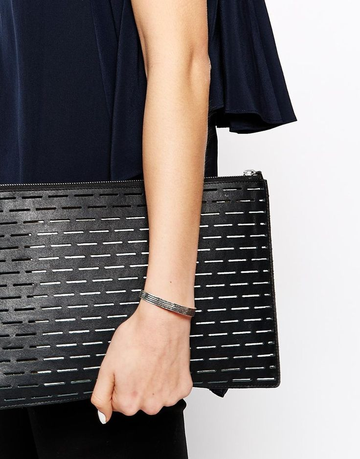 whistles | laser cut leather clutch.