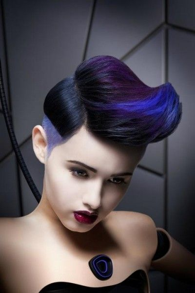 Avant garde hairstyle with voluminous upward  fringe.  Wow those colors are so well blended and still popping!