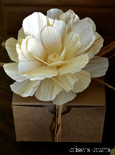 Flowers made out of corn husks.  Would be pretty to make smaller ones for napkin holders at the Thanksgiving table.