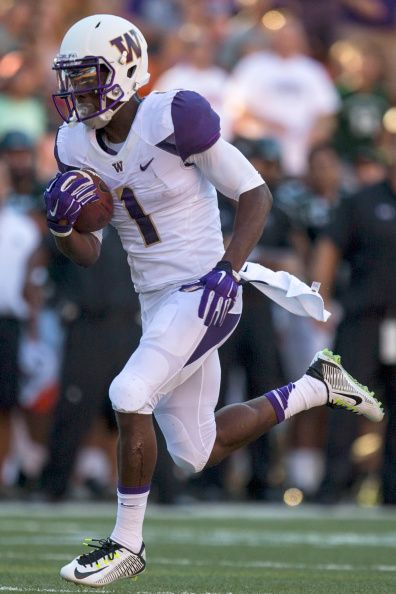 John Ross of the Washington Huskies runs in for a touchdown against the Hawaii Warriors during a college football game at Hawaiian Airlines field at...